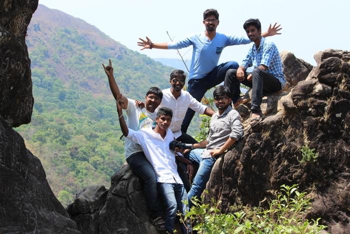 male friends posing on rocks